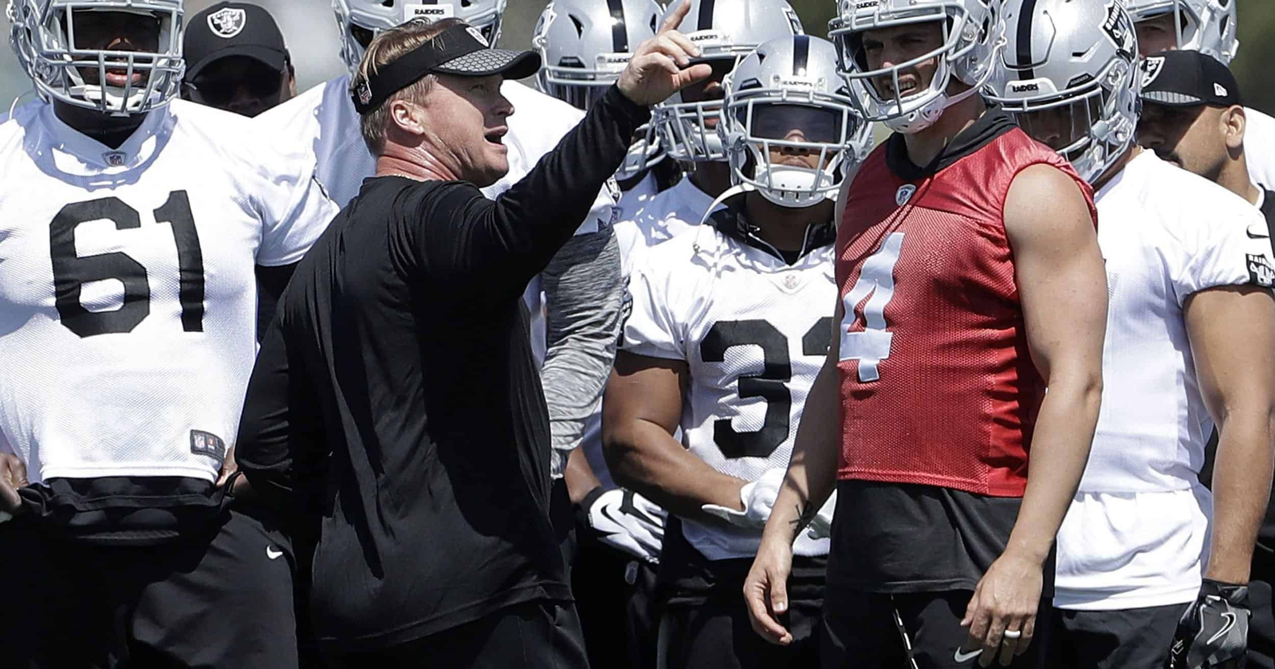 Oakland Raiders head coach Jon Gruden and Derek Carr