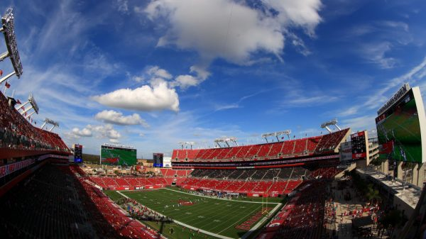 What is the Super Bowl Experience in Tampa Bay this year, and how will the NFL's OnePass app help?