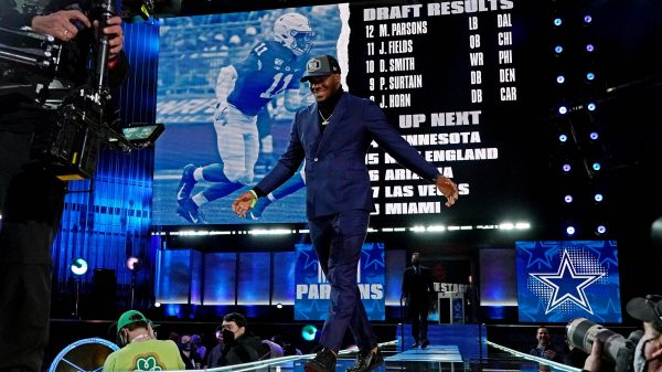 Micah Parsons walks across the 2021 NFL Draft stage following his selection via the Dallas Cowboys