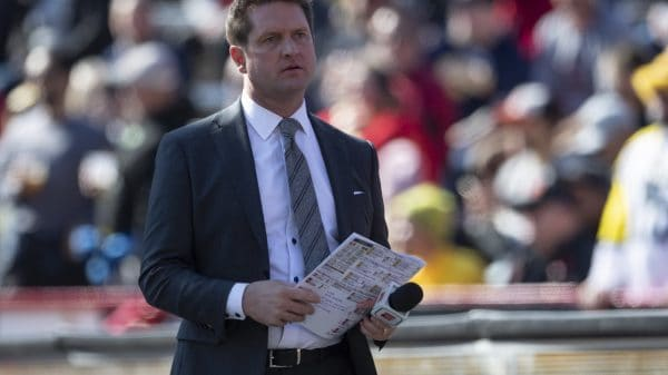 NFL Draft Analyst Todd McShay stands on a football sideline in 2019