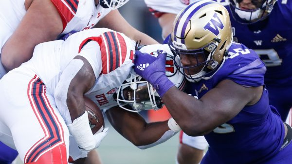 Former University of Washington defensive tackle Levi Onwuzurike making a tackle