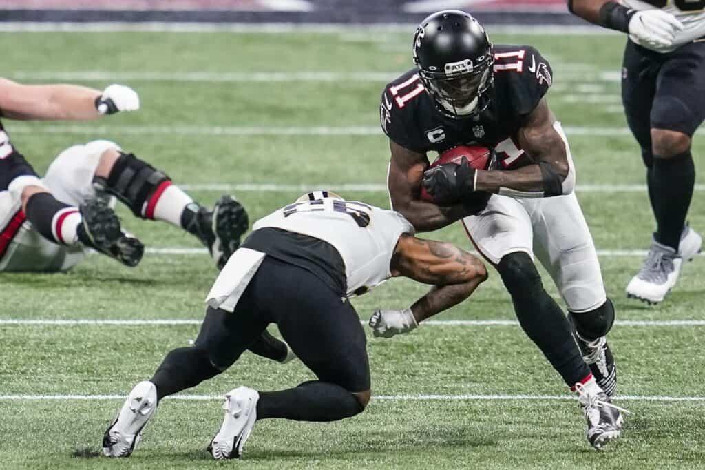 Julio Jones runs through a tackle against the New Orleans Saints
